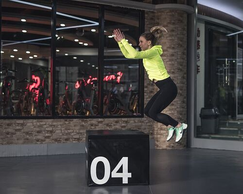 photo-of-woman-jumping-on-box